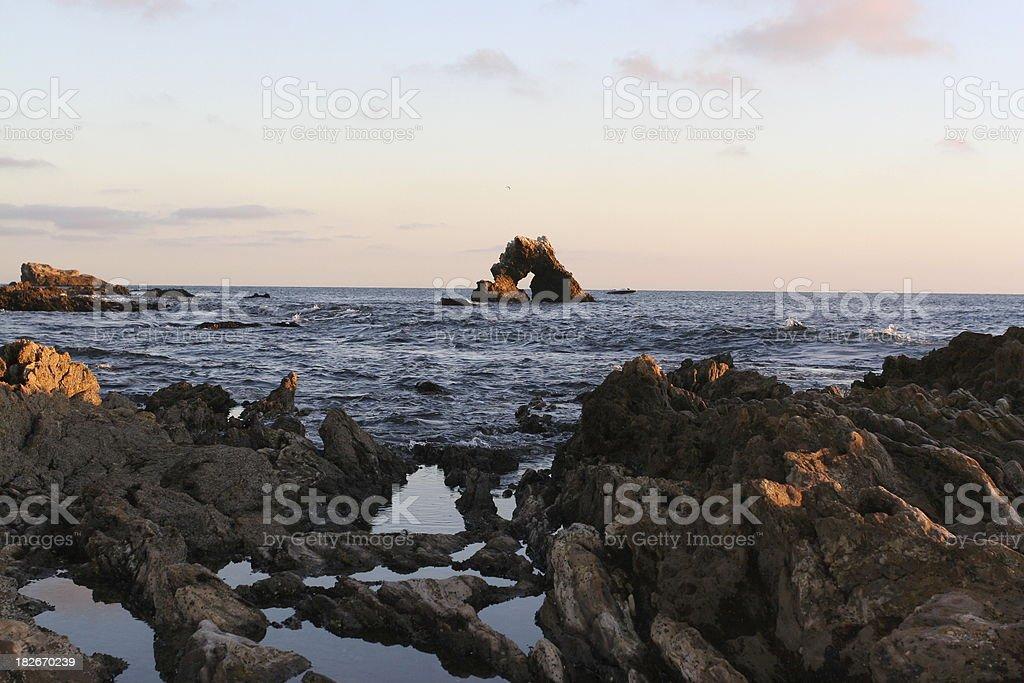 Rocky Newport Beach coast at sunset royalty-free stock photo