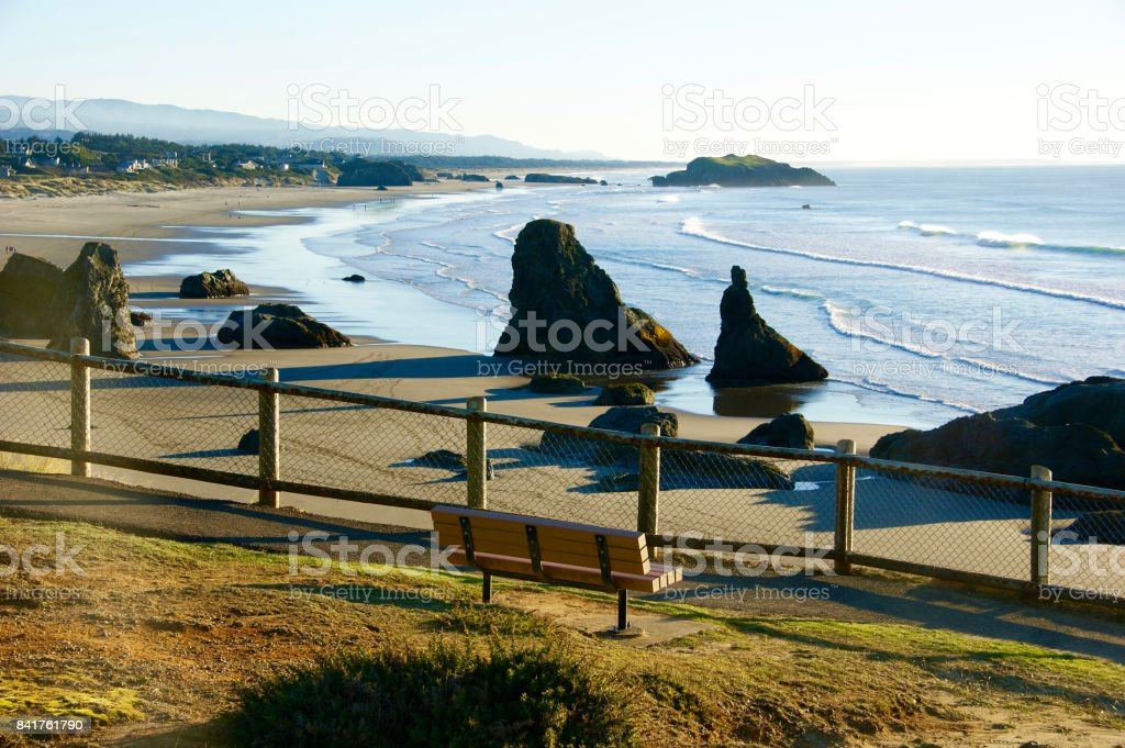 Rocky Pacific Northwest beach with a fence in the foreground stock photo