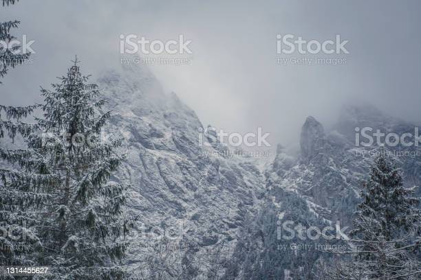 Photo of Rocky peaks covered with clouds