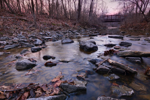Rocky River Bed with Bridge stock photo