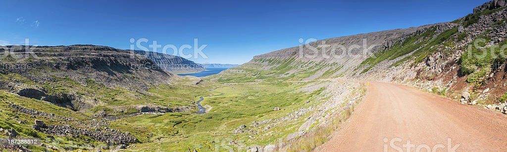 Rocky road through Arctic Circle mountain fjord wilderness panorama Iceland royalty-free stock photo