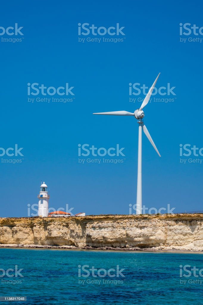Rocky seashore and Windmills