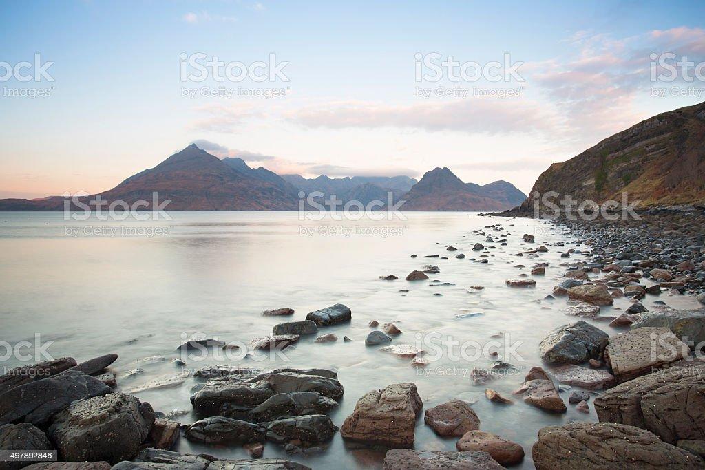 rocky shore an mountain landscape stock photo