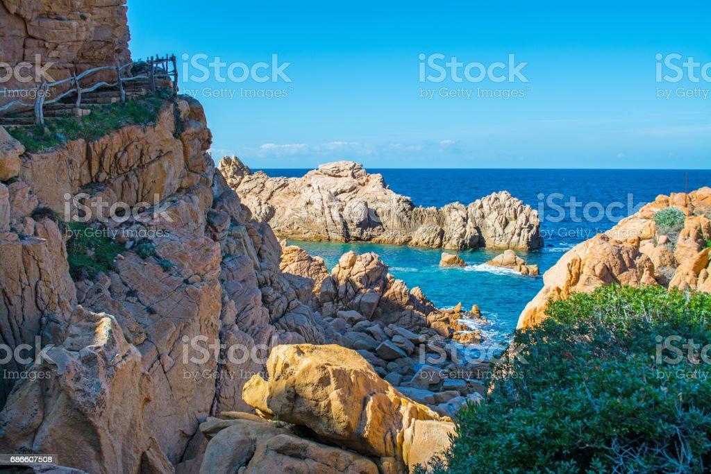 Rocky shore and blue sea royalty-free stock photo