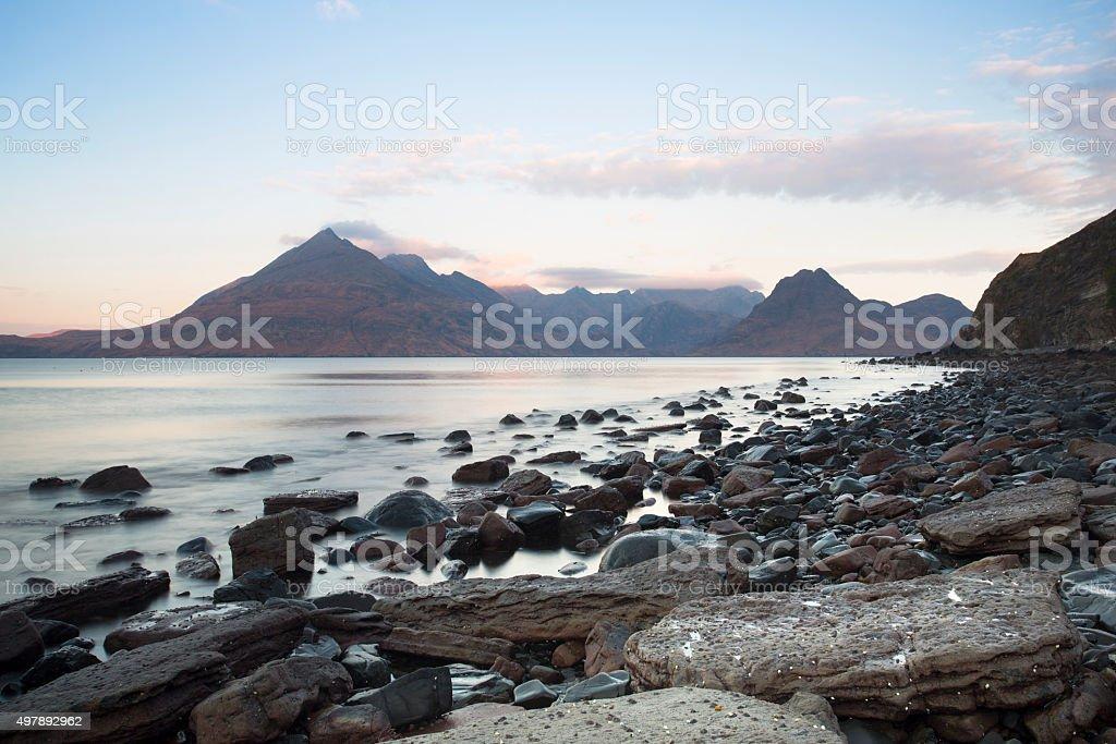 rocky shore and mountain landscape stock photo