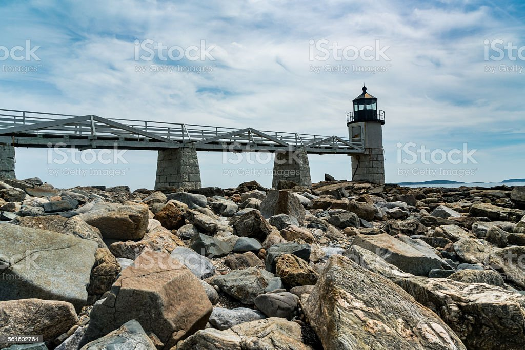 Rocky Shore Beaneath Ocean Lighthouse stock photo