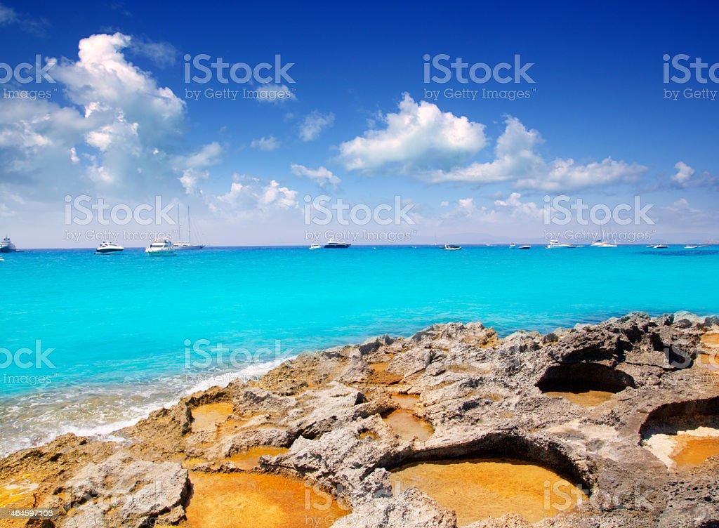 Rocky shore of formentera turquoise sea stock photo