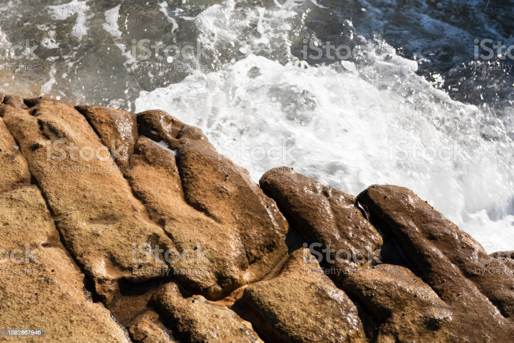 Rocky shore of Greek Island in Aegean Sea stock photo