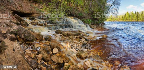 Photo of Rocky shore of the river and the waterfall