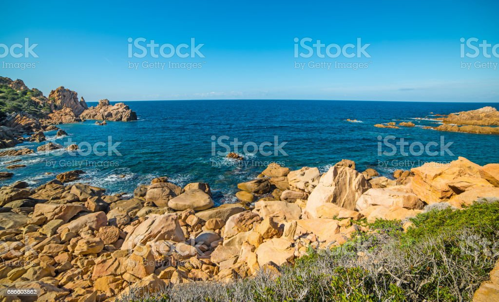 Rocky shore with blue sea royalty-free stock photo