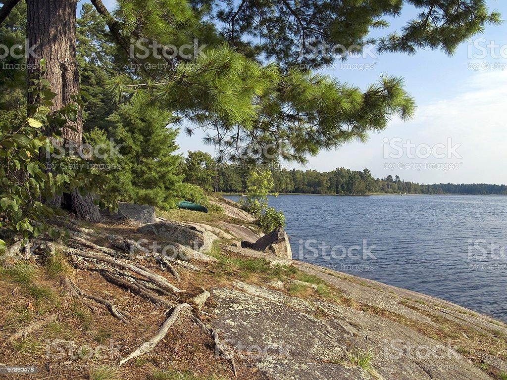 Rocky Shore with Canoe royalty-free stock photo