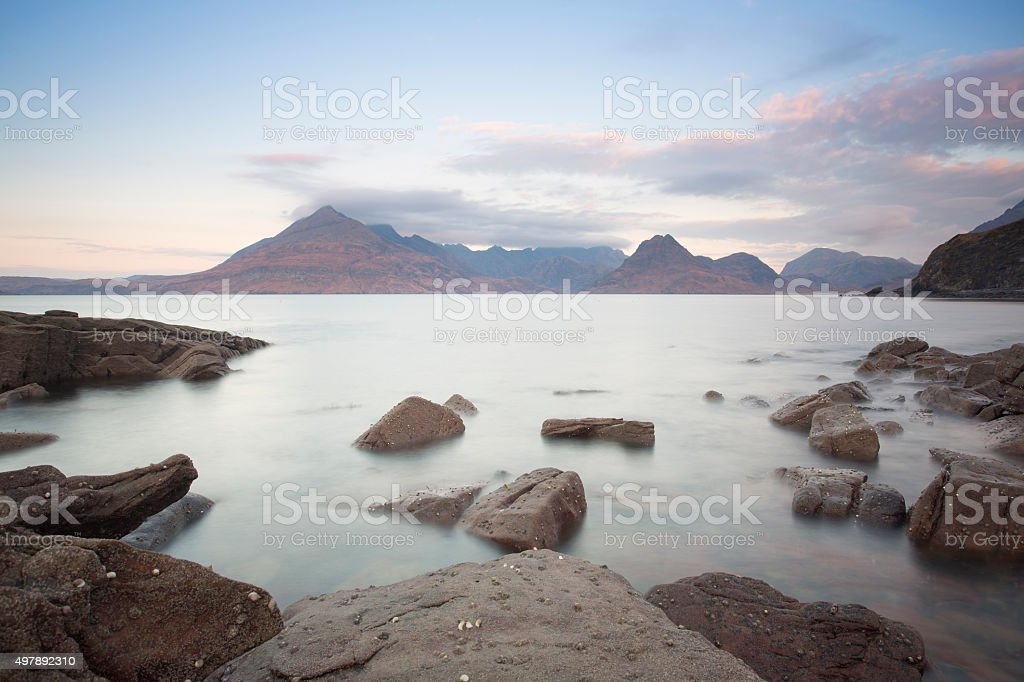rocky shore with mountains stock photo