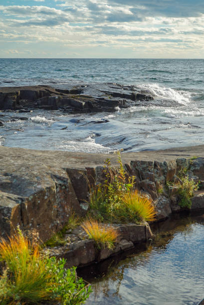 Rocky Shoreline of Lake Superior with Waves and Fall Color stock photo