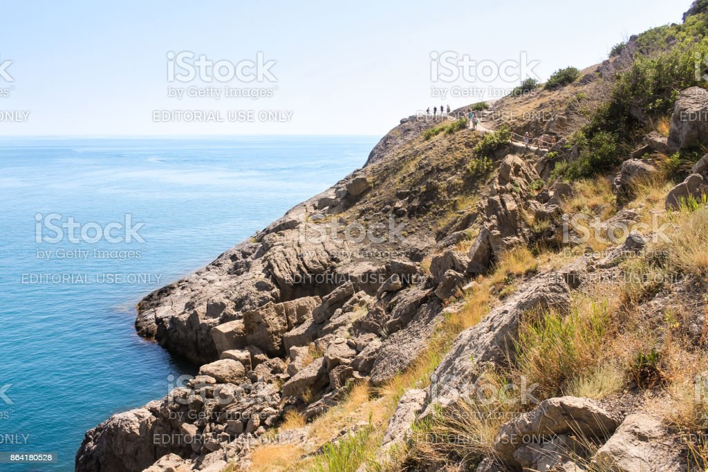 Rocky slope to the beach. royalty-free stock photo