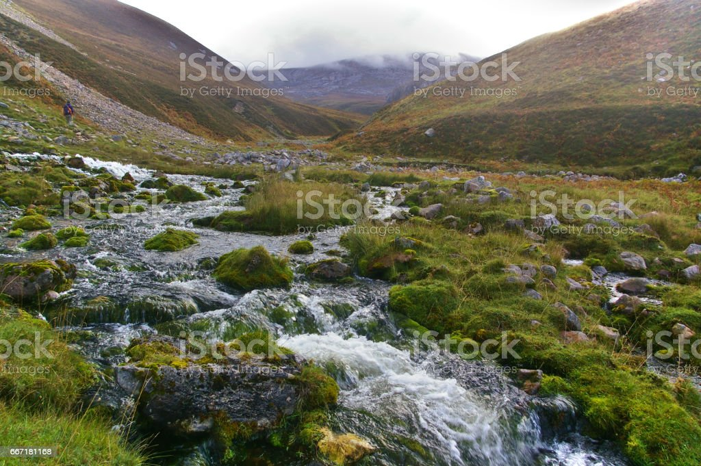 Rocky stream running through a valley in the Scottish highlands stock photo