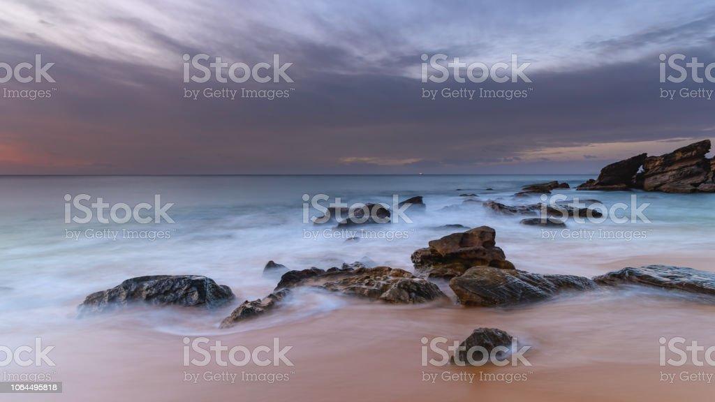 Rocky Sunrise at the Seaside stock photo