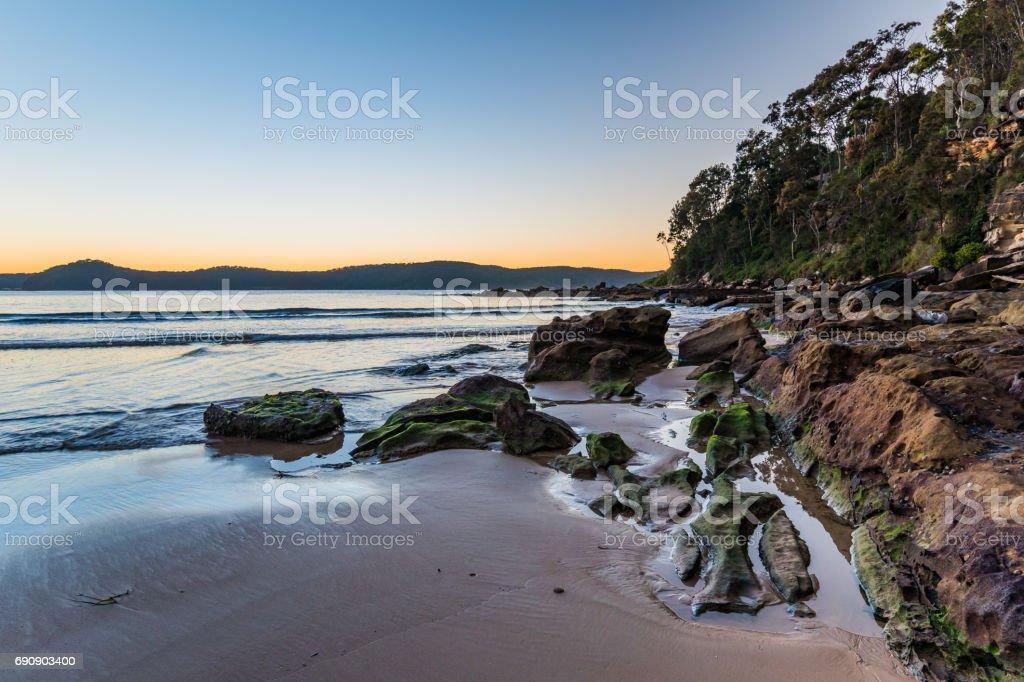 Rocky Sunrise Seascape stock photo