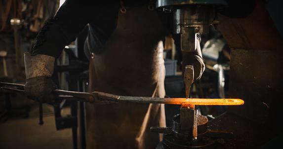 istock Rod hot iron on the anvil. 806729998