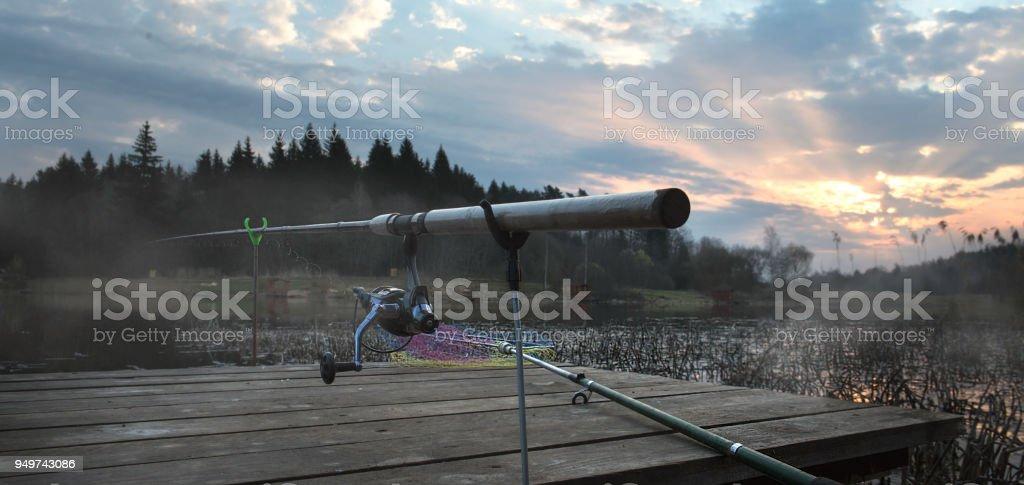 Rod on a wooden bridge stock photo