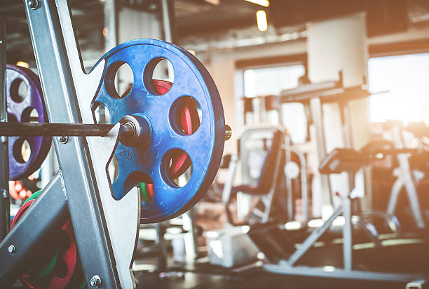 rod with weights - exercise equipment stock photos and pictures