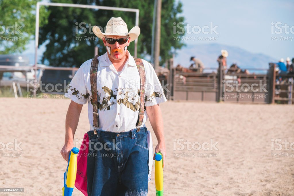 Rodeo clown holding water pistols stock photo
