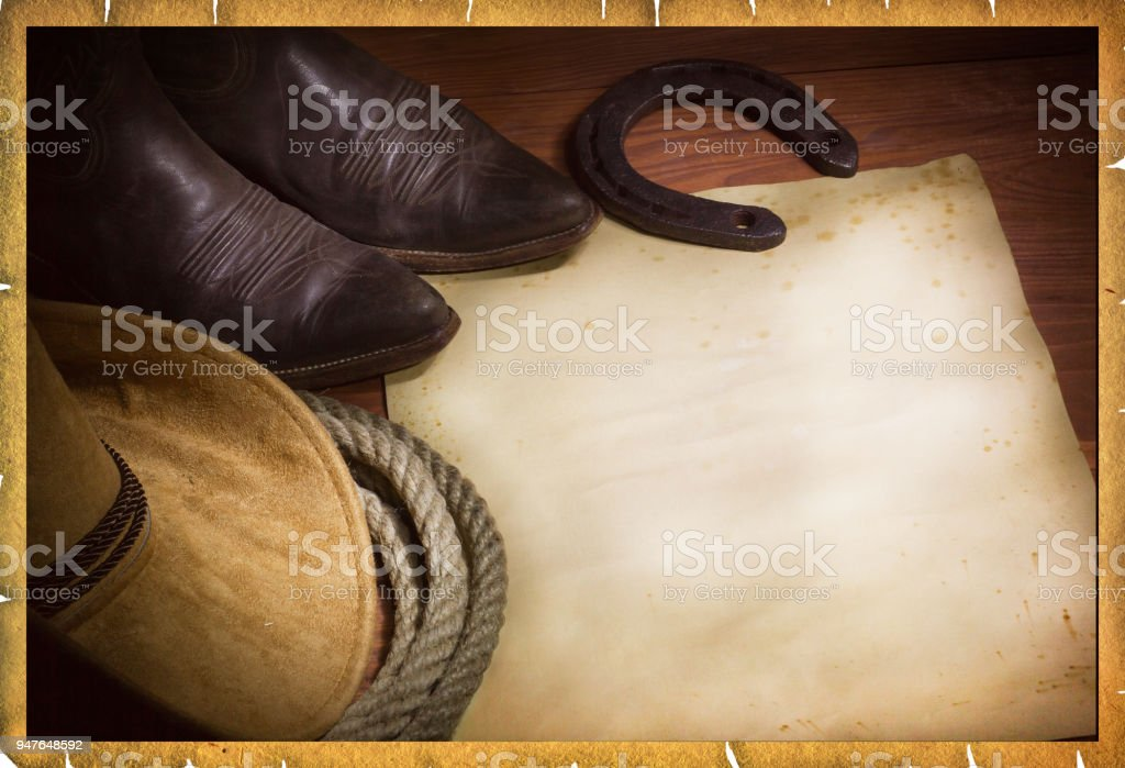 Rodeo cowboy background with western hat and lasso stock photo