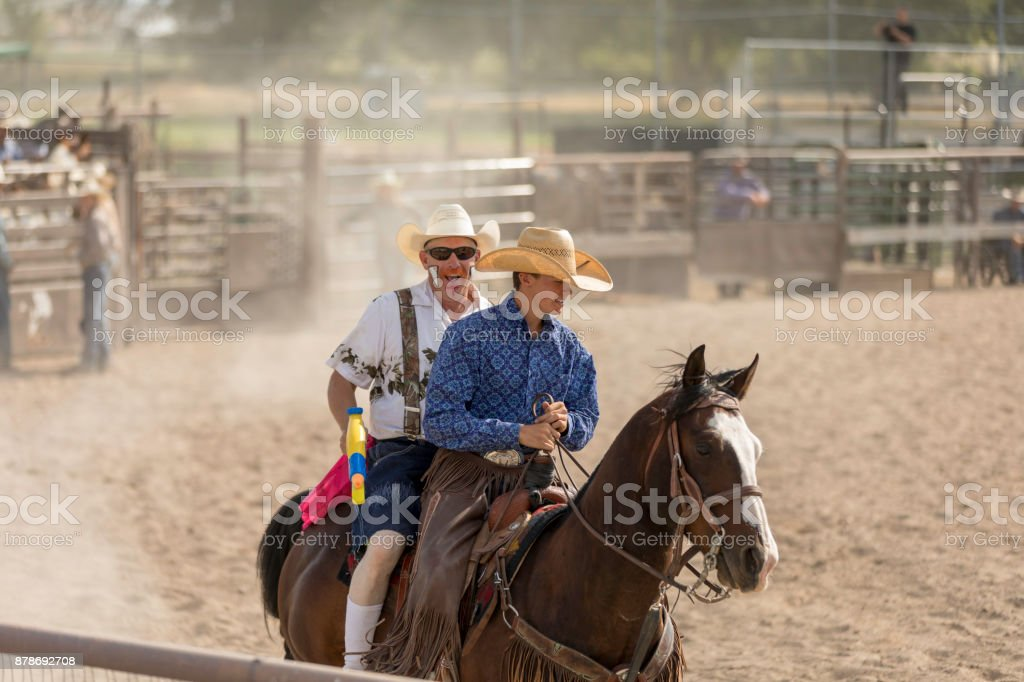 Rodeo Cowboys and Rodeo Clown stock photo