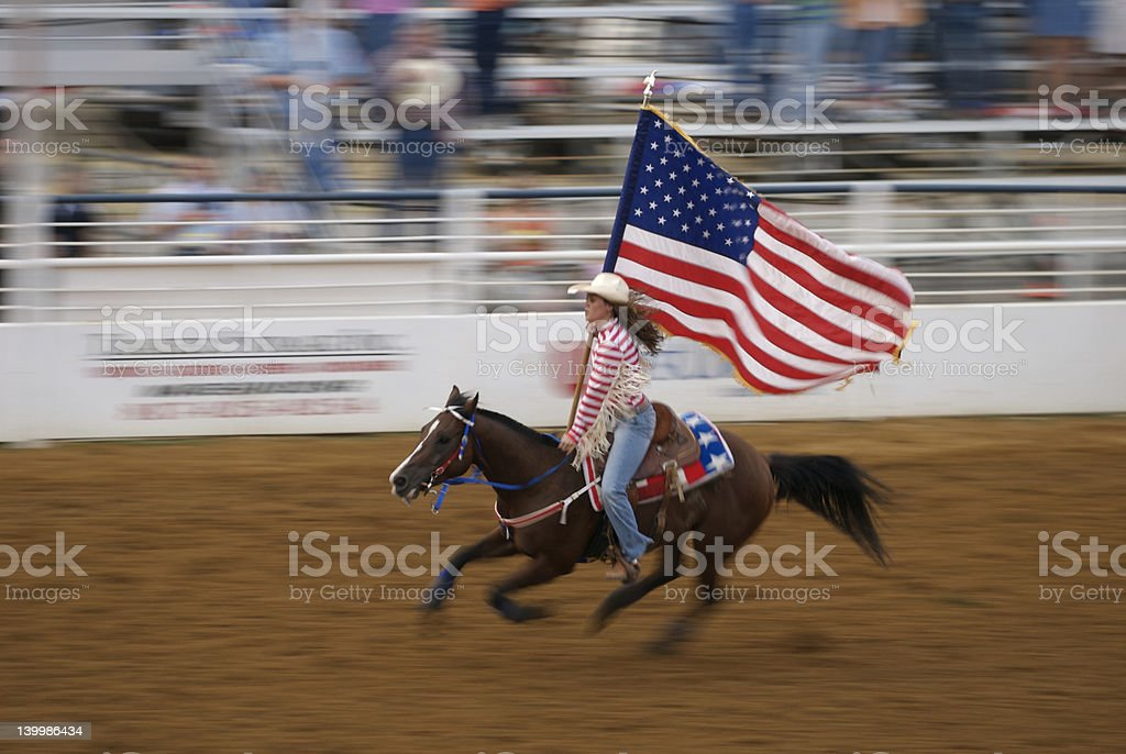 Rodeo Cowgirl and American Flag stock photo
