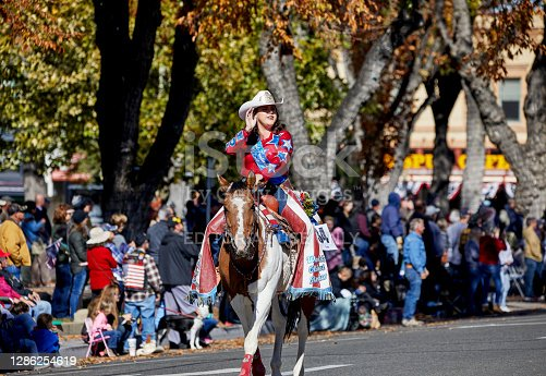 istock Rodeo Queen on Horse marching in Veteran's Day Parade 1286254619