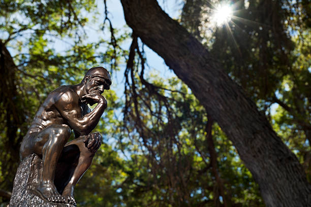 Rodin's The Thinker in Woods stock photo