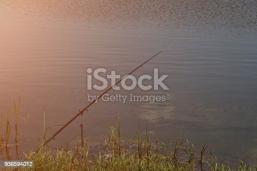 1094918172 istock photo Rods on a rod pod with the swingers attached ready to catch some fish 936594012