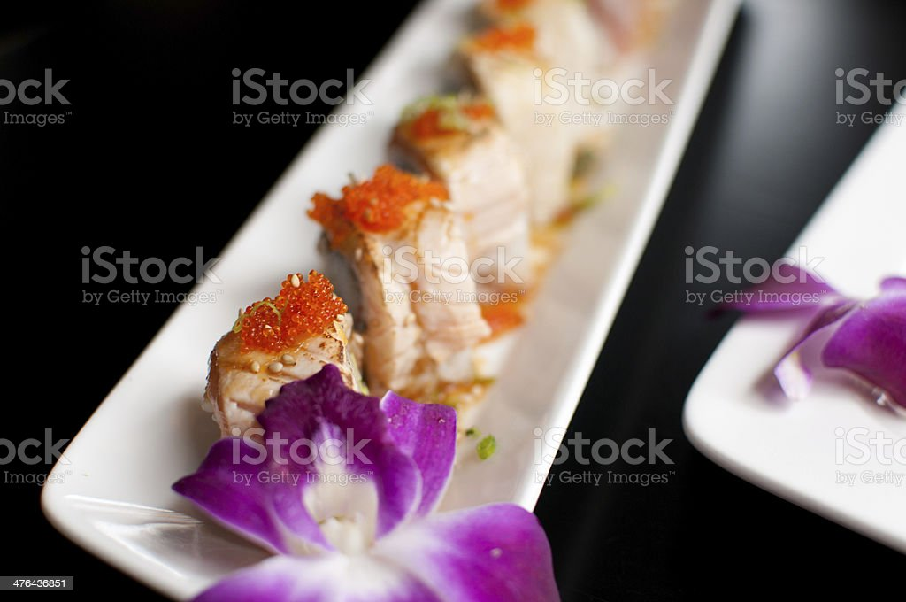 Roe caviar on top of sushi roll royalty-free stock photo