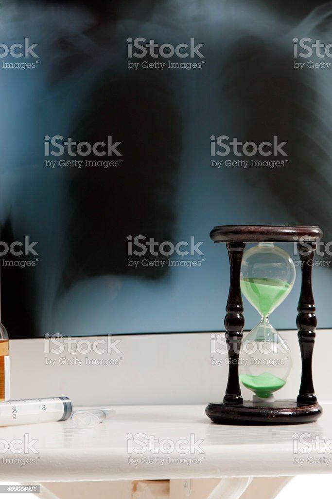 Roentgen, hourglass and medicine stock photo