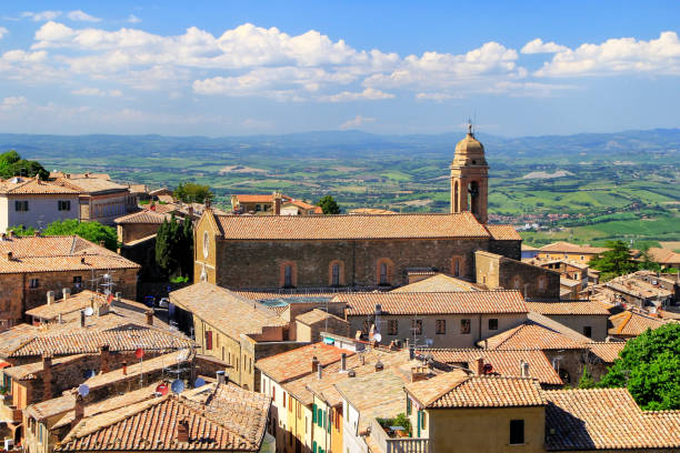 Roftops of houses and Sant'Agostino Church in Montalcino, Val d'Orcia, Tuscany, Italy. stock photo