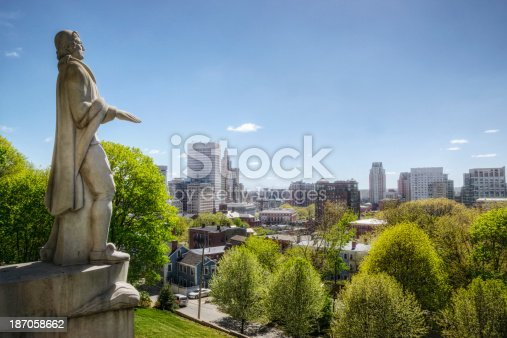 Statue of theologian and Rhode Island icon Roger Williams overlooking downtown Providence on a sunny day in early summer. The statue was sculpted by Leo Friedlander in the late 1930s after Williams' descendant Stephen Randall made a deed of gift for the monument. The approximate 15-foot tall granite statue commemorates Williams' founding of the state of Rhode Island and his promotion for religious freedom.
