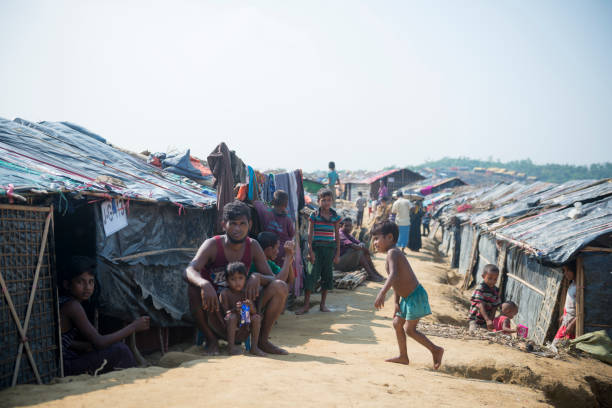 Rohingya life in Bangladesh Rohingya Muslims, who recently fled government-sanctioned violence in Myanmar, outside their shelters at Jamtoli refugee camp near Cox's Bazar, Bangladesh (October 26, 2017) rohingya culture stock pictures, royalty-free photos & images