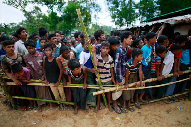 Rohingya Muslims Flee Violence In Myanmar Rohingya Muslims, who crossed over from Myanmar into Bangladesh, waits to get aid at Balukhali refugee camp, Bangladesh, October 2, 2017. The United Nations' humanitarian office said Thursday that the number of Rohingya Muslims fleeing to Bangladesh since Aug. 25 has topped 500,000. rohingya culture stock pictures, royalty-free photos & images