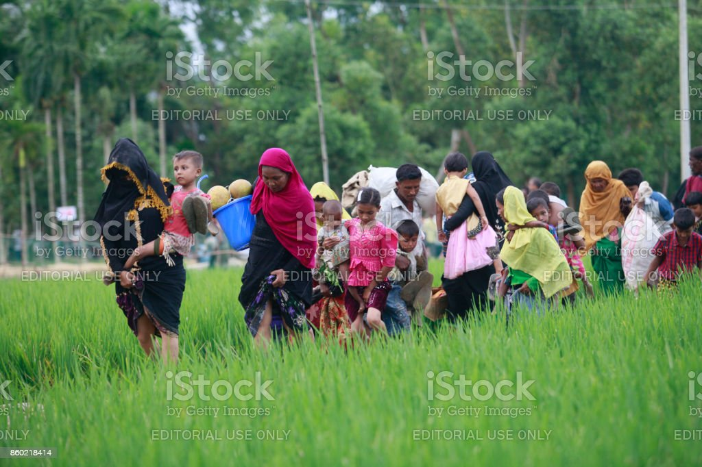 Rohingya Muslims Flee Violence In Myanmar Rohingya Muslims, who crossed over from Myanmar into Bangladesh, walks through muddy field to take shelter at Balukhali refugee camp, Bangladesh, October 2, 2017. The United Nations' humanitarian office said Thursday that the number of Rohingya Muslims fleeing to Bangladesh since Aug. 25 has topped 500,000. 2017 Stock Photo
