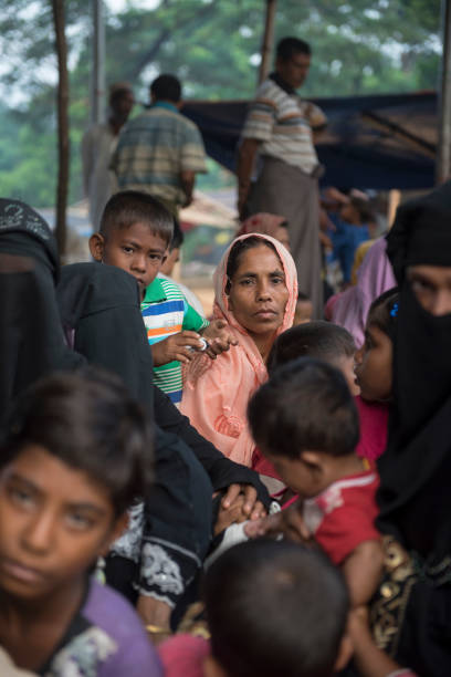 Rohingya refugees in Bangladesh Newly arrived Rohingya Muslims from Myanmar wait to complete the registration process at Kutupalong refugee camp in Bangladesh. (October 29, 2017) rohingya culture stock pictures, royalty-free photos & images