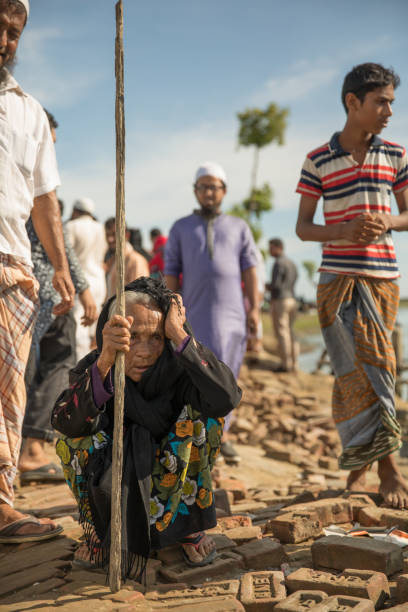 Rohingya woman after she reached Bangladesh Rohingya woman after she reached Bangladesh. She escped from Myanmar on 27th of October 2017. rohingya culture stock pictures, royalty-free photos & images