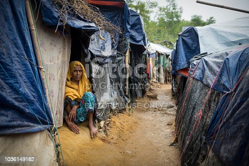 A woman, one of the 600,000 Rohingya who fled Myanmar in the two months beginning on August 25, 2017, sits at the entrance to her shelter in Kutupalong refugee camp in Bangladesh. (October 29, 2017)