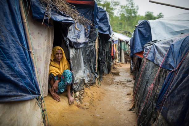 Rohingya woman and shelters at Kutupalong refugee camp in Bangladesh stock photo