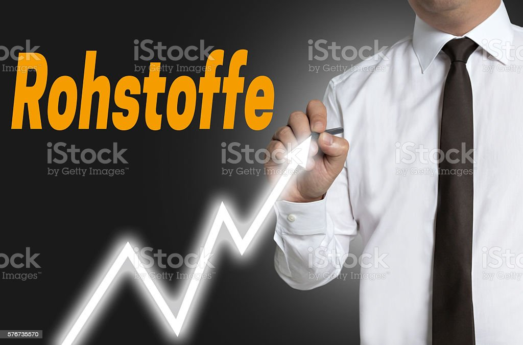 Rohstoffe (in german Raw materials) trader draws market price on stock photo