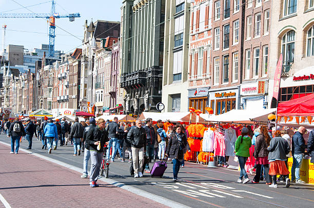 Rokin during the King's Day in Amsterdam. Amsterdam, the Netherlands - April 27, 2015: Rokin during the King's Day crowd of people go celebrate the festival. prince musician stock pictures, royalty-free photos & images