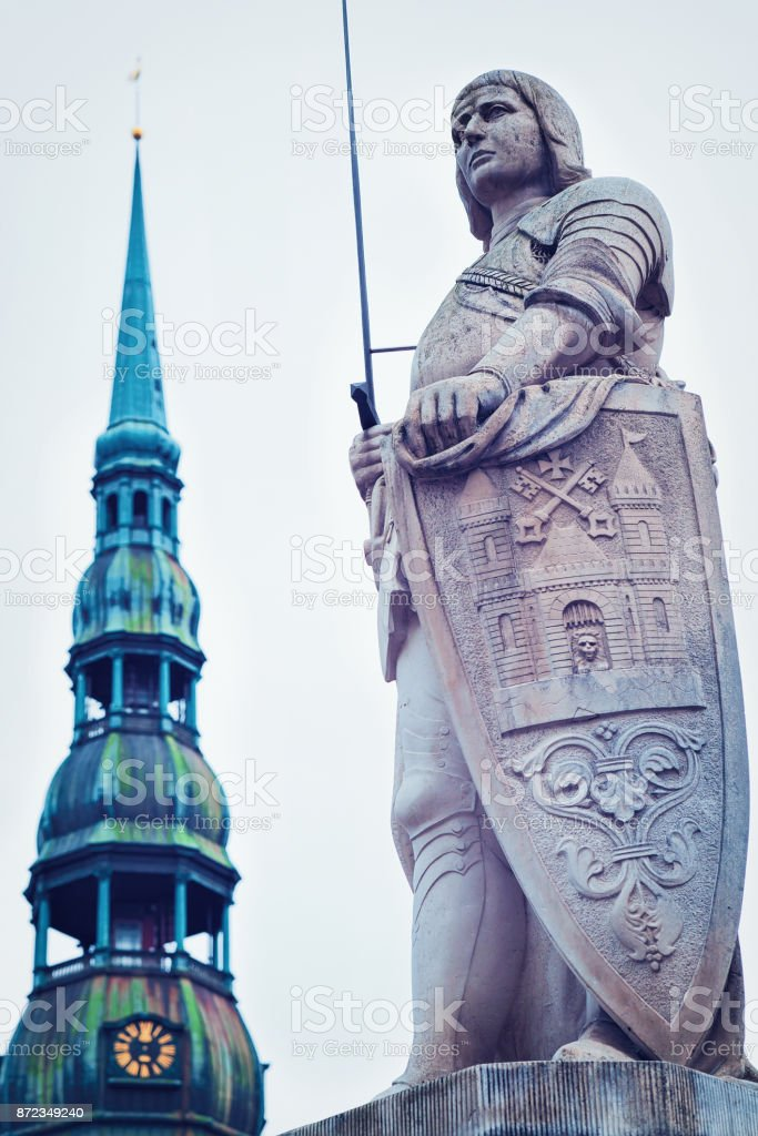 Roland Statue and Clock tower of St Peter Church Riga stock photo