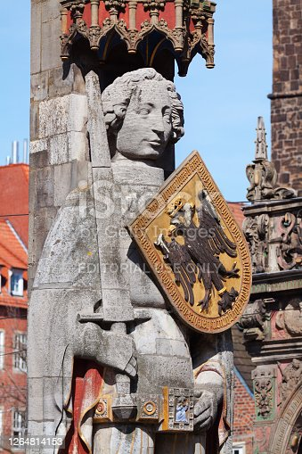 Roland statue with shield and sword in Bremen. Medieval statue in front of town hall. Roland statues are common sign of freedom and rights of cities in medieval times in saxon areas. Artist unknown, made in 1404 as sign of law