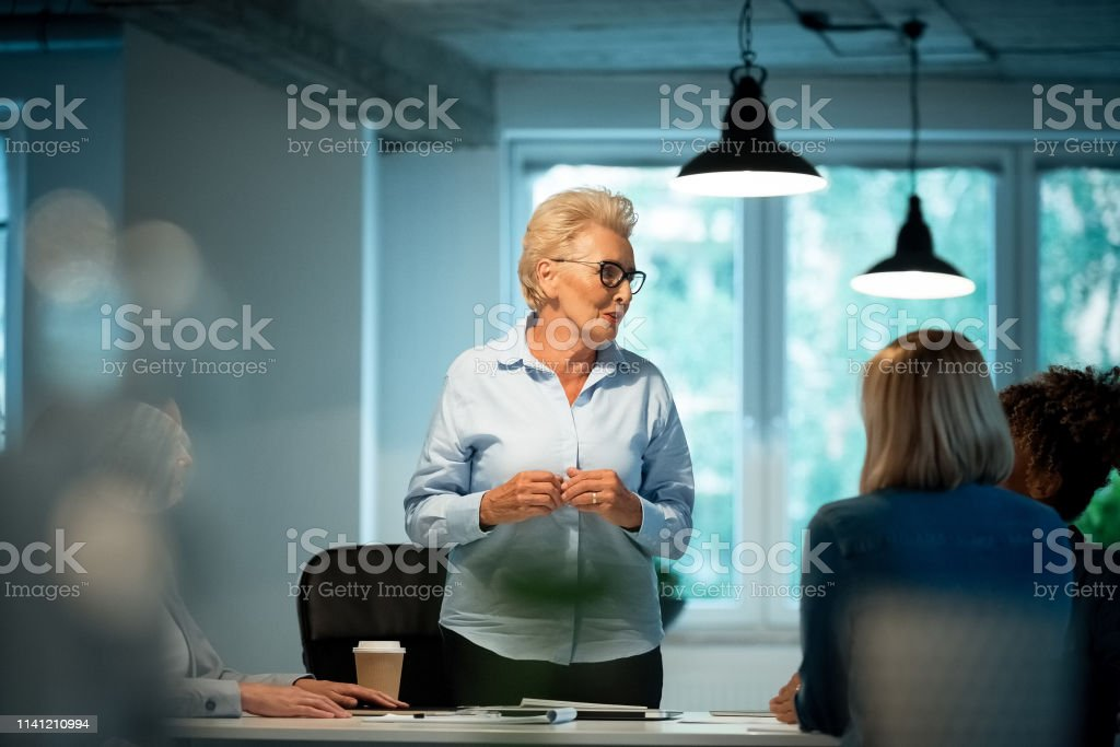 Role model advising businesswomen in new office Role model advising businesswomen in new office. Female executives are planning business strategy for start-up. They are dedicated towards their work. 35-39 Years Stock Photo