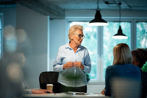 Role Model Advising Businesswomen In New Office Stock Photo - Download Image Now