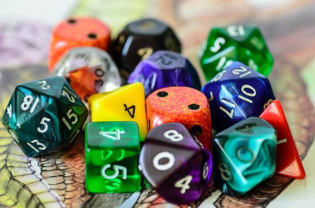 role playing dices lying on picture background - veelvlakkig stockfoto's en -beelden