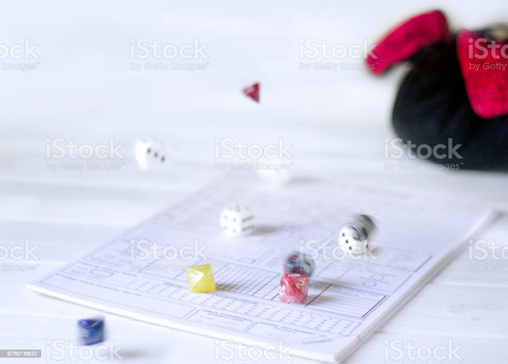 Role playing rolling dices stock photo